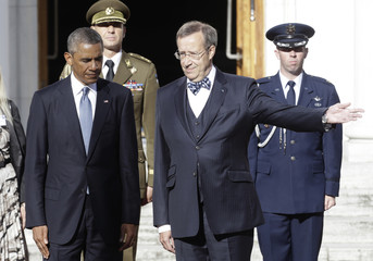 Estonia's President Toomas Hendrik Ilves welcomes U.S. President Barack Obama to their meeting after a welcome ceremony in Tallinn