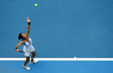 King of the U.S. serves to Wozniacki of Denmark during their match at the Australian Open tennis tournament in Melbourne