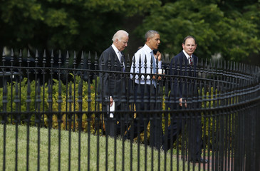 U.S. President Barack Obama walks back to the White House after announcing his choice of former Procter & Gamble Chief Executive McDonald, an Army veteran, as his nominee to be the next secretary of veterans affairs at the VA in Washington