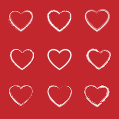 Collection of hand drawn hearts on red background. Vector.