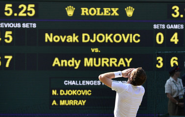 Andy Murray of Britain celebrates as he defeats Novak Djokovic of Serbia in their men's singles final tennis match at the Wimbledon Tennis Championships, in London