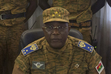 Burkina Faso's military chief General Honore Traore speaks at a news conference announcing his takeover of power, at army headquarters in Ouagadougou