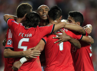 Benfica's players celebrate with Luisao after he scored a goal against Anderlecht during their Champions League soccer match at the Luz Stadium in Lisbon