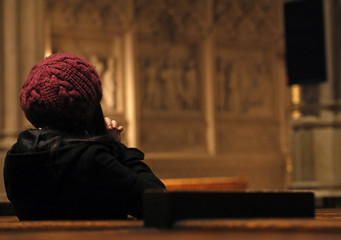 A woman prays during a mass at St. Patrick's Cathedral in New York