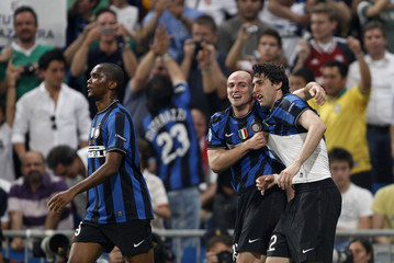 Inter Milan's Milito celebrates with team-mate Cambiasso after his second goal against Bayern Munich during their Champions League final soccer match in Madrid