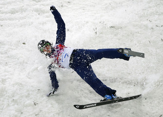 Emily Cook of U.S. crashes during the women's freestyle skiing aerials finals at the 2014 Sochi Winter Olympic Games in Rosa Khutor