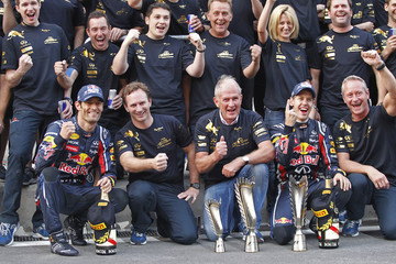 Red Bull Formula One driver Sebastian Vettel of Germany teammate Mark Webber and team principal Christian Horner pose for a picture as they celebrate in the pit lane after Vettel won the South Korean F1 Grand Prix at the Korea International Circuit in Yeon