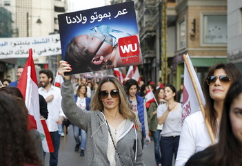 A protester holds up a sign during a protest against what demonstrators say is the government's failure to resolve a crisis over rubbish disposal in Beirut