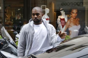 Rapper Kanye West  arrives at a fashion designer shop in Paris