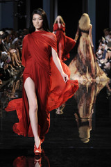 Models present creations by Lebanese designer Elie Saab as part of his Fall/Winter 2010-2011 Haute Couture fashion show in Paris