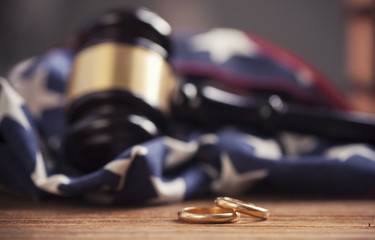 Close-up Of Wedding Rings  on wooden table with american flag