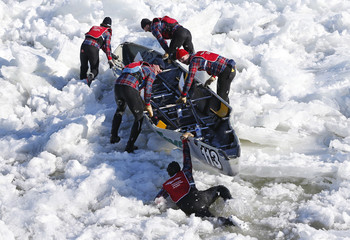 A member of Team Stein Monast falls into the water during the Quebec Winter Carnival ice canoe race in Quebec City