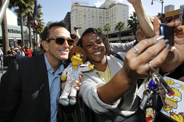 """Azaria who gives voice to Chief Wiggum poses for a photo with a fan after the ceremony where Matt Groening, creator of """"The Simpsons,"""" was honored with a star on the Walk of Fame in Hollywood"""