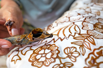 Painting watercolor on the fabric to make Batik Batik-making is part of Indonesian culture