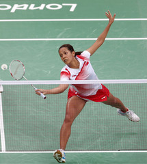 Singapore's Shinta Mulia Sari and Yao Lei play against Japan's Reika Kakiiwa and Mizuki Fujii during their women's doubles group play stage badminton match at the Wembley Arena during the London 2012 Olympic Games