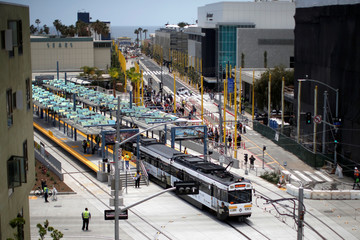 A train pulls out of Santa Monica station in front of the newly pedestrianized street to the Santa Monica pier on L.A. Metro's new $1.5 billion Expo Line extension that connects downtown to the beach for the first time in 63 years, in Santa Monica