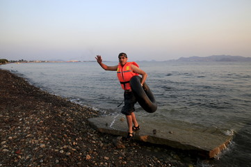 A Syrian refugee arrives at a beach on the Greek island of Kos