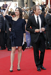 Actors Pailhas and Thompson arrive on the red carpet at the 63rd Cannes Film Festival