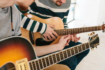 Learning to play the guitar. Music education.