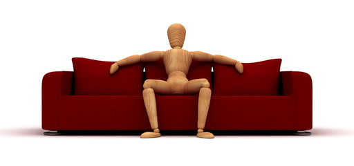 Mannequin Sitting On Red Sofa