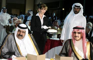 Emir of Qatar Hamad Bin Khalifa al-Thani and Saudi Prince Alwaleed bin Talal attend the gala dinner with GCC Chambers in Doha