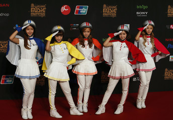 South Korean group Crayon Pop poses on the red carpet during the Mnet Asian Music Awards in Hong Kong
