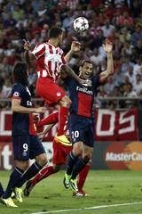 Paris St Germain's Ibrahimovic is challenged by Olympiakos' Medjani during their Champions League soccer match at Karaiskaki stadium in Piraeus