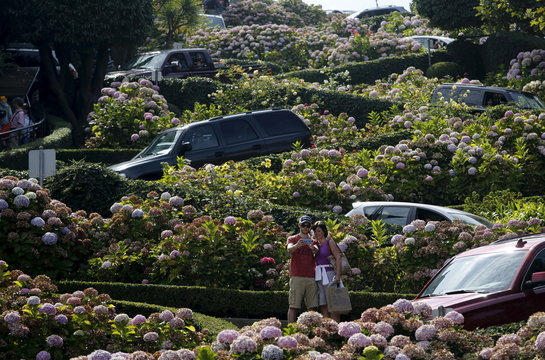 Tourists snap photos on Lombard Street in San Francisco