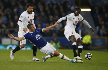 Everton's Phil Jagielka in action with Watford's Abdoulaye Doucoure and Troy Deeney