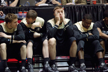 The Colorado University bench react during the final moments of their over UNLV during their men's NCAA basketball game in Albuquerque