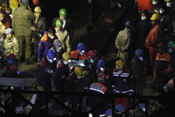 A body of miner is carried to an ambulance in Soma