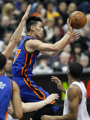 New York Knicks guard Jeremy Lin passes the ball back to teammate Steve Novak in game against Timberwolves