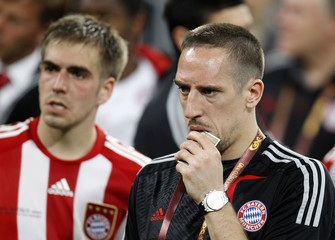 Bayern Munich's Franck Ribery and Philipp Lahm react after being defeated by Inter Milan in their Champions League final soccer match at the Santiago Bernabeu stadium in Madrid