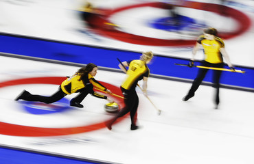 New Brunswick skip Crawford throws a rock against British Columbia during the Scotties Tournament of Hearts curling championship in Kingston