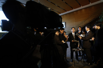 Kishida listens to questions from reporters at PM Abe's official residence in Tokyo