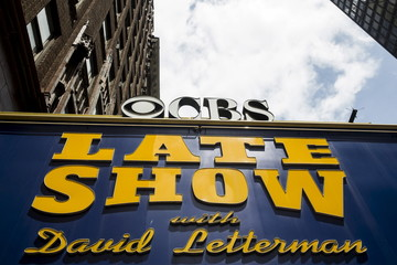 """A marquee for """"The Late Show"""" with David Letterman stands outside of the Ed Sullivan Theater in Manhattan during taping of the final edition of the show in New York"""