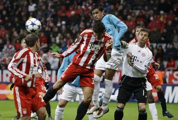 Cadu, captain of CFR Cluj scores his team's first goal during their Champions League soccer match against Bayern Munich in Munich