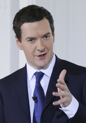 Britain's Chancellor of the Exchequer Osborne gestures during an election campaign event in London