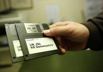 Peter Breiter, CEO of Raiffeisen Gammesfeld eG bank, displays the latest floppy disks at the bank in Gammesfeld, Baden-Wuerttemberg