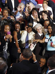 U.S. President Barack Obama salutes a veteran in the crowd after delivering remarks at Xavier University in New Orleans, Louisiana