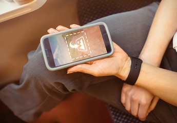 Smartphone User on Public Transit Mockup