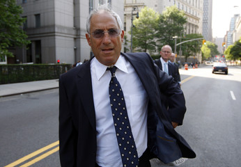 Mark Kurland departs federal court after being sentenced to 27 months in prison, in New York