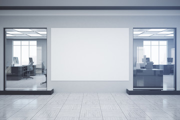 Bright office with empty poster