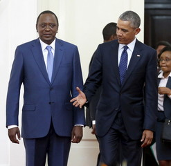 U.S. President Obama reaches out to shake hands with Kenya's President Kenyatta as they arrive for a bilateral meeting at the State House in Nairobi