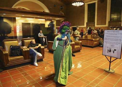 """Performer from L.A. Dance Project dances during dress rehearsal for the experimental opera """"Invisible Cities"""", which is presented inside the historic Los Angeles Union Station in California"""