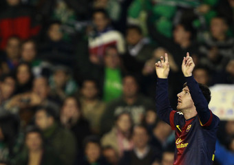 Barcelona's Messi celebrates after scoring his first goal against Real Betis during their soccer match in Seville