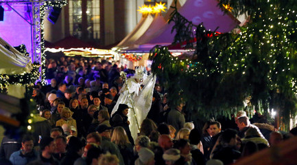 People visit the opening of the Christmas market at Gendarmenmarkt square in Berlin