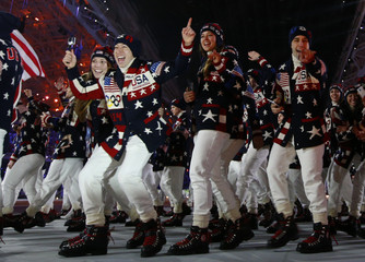 Delegation members of the U.S. parade during the opening ceremony of the 2014 Sochi Winter Olympic Games at Fisht stadium