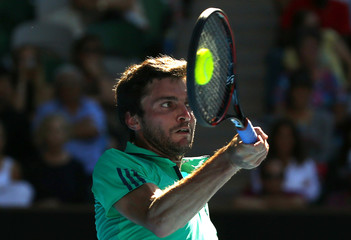 France's Simon hits a shot during his fourth round match against Serbia's Djokovic at the Australian Open tennis tournament at Melbourne Park