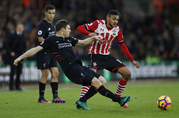 Liverpool's James Milner in action with Southampton's Sofiane Boufal